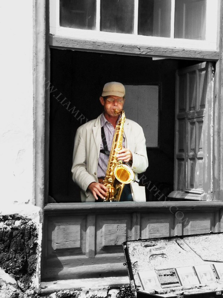Saxafone Player, Teguise, Lanzarote. I rounded the corner on a market day in Teguise where this musician was performing in the window of a restaurant. Teguise was once the Capitol of Lanzarote