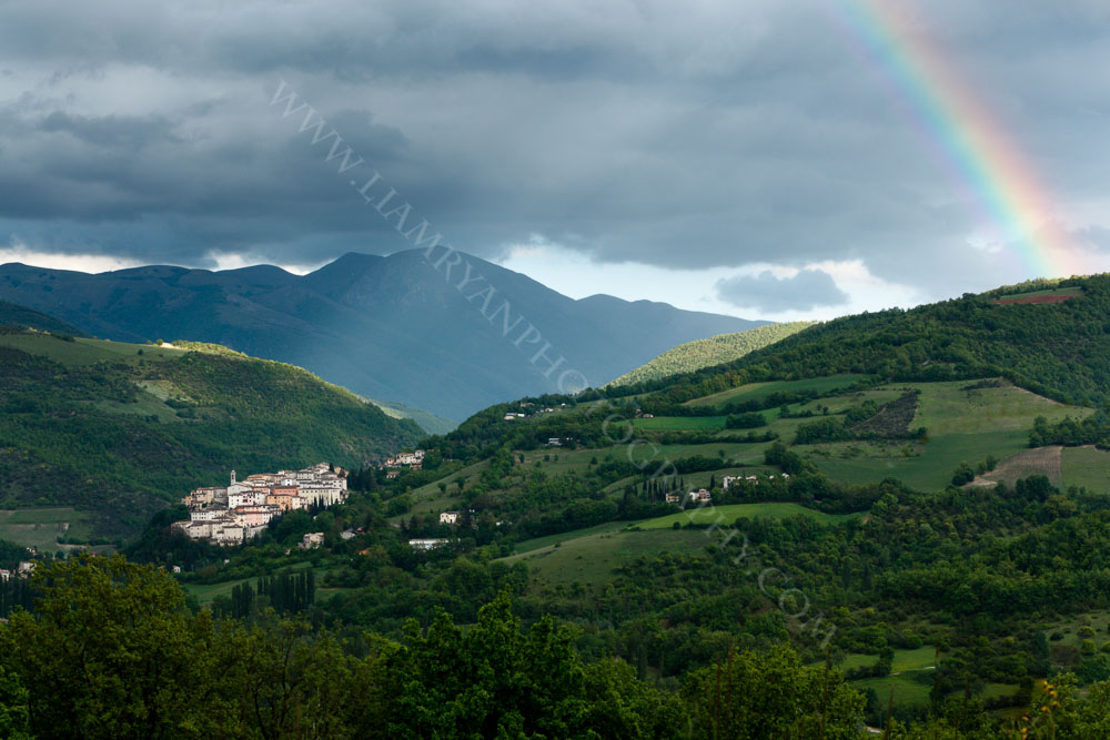 The Village of Preci with Rainbow. Monti Sibillini National Park, Umbria, Italy
