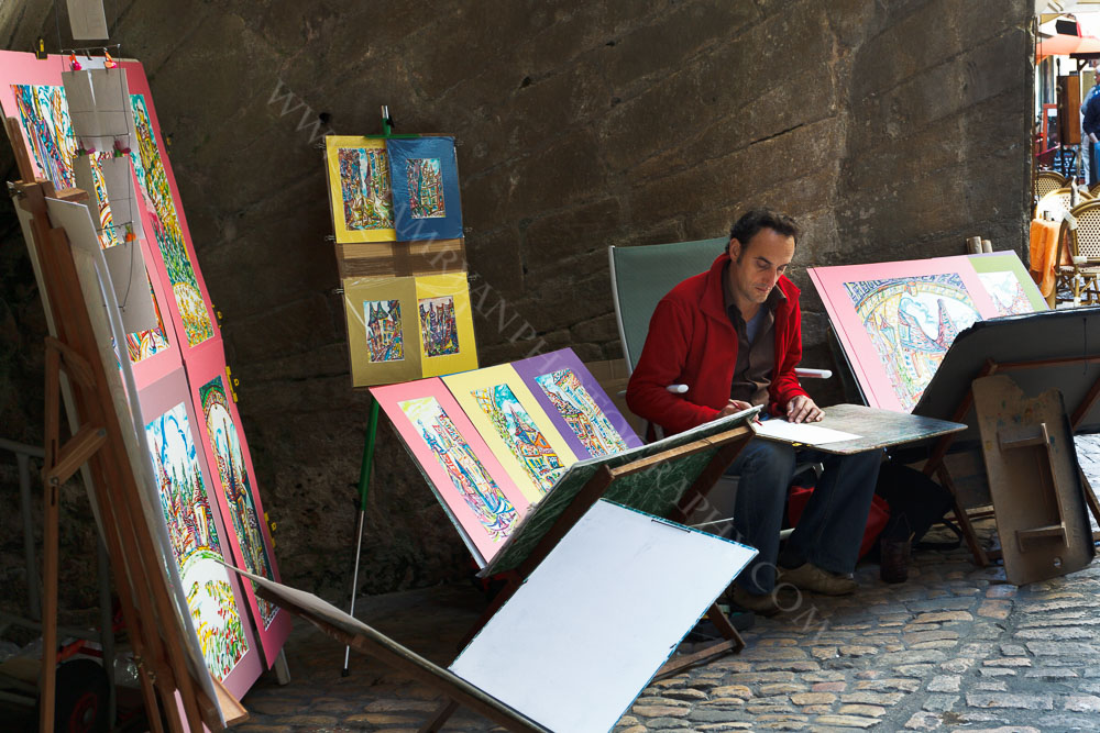 Street Artist Selling His Work on Market Day Sarlat, Dordogne France