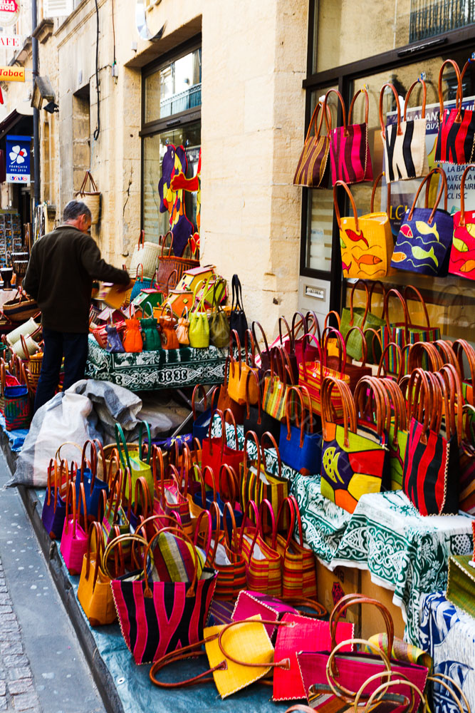 A colourful bag shop on market day, Sarlat Dordogne France