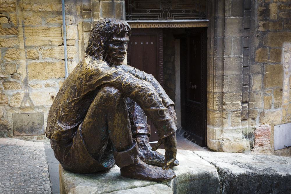 This bronze statue keeps watch over Place de la Liberté, Sarlat, Dordogne, France