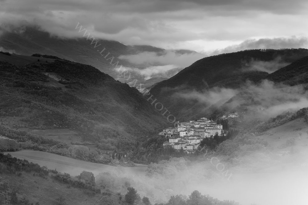 Early morning mist rising from Preci captured in Black and White. Monti Sibillini National Park, Umbria, Italy