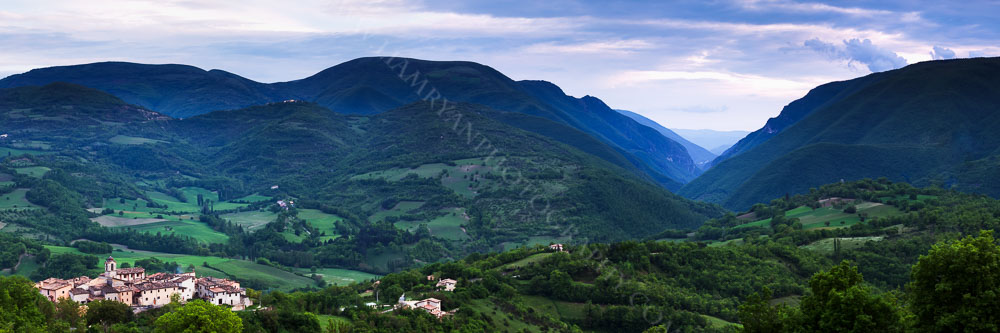 Late evening panorama with the  mountains of Monti Sibillini National Park beyond, Umbria, Italy